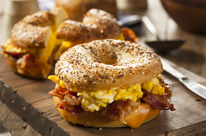 Bacon, cheddar, and poached egg bagel